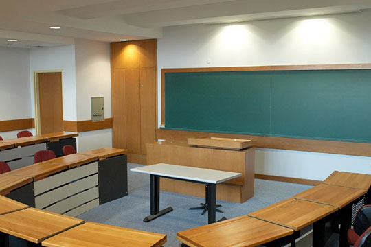 Modern Classroom Desks ~ Modern classroom with desks chairs and chalkboard