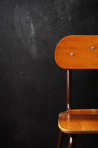 student desk chair and blackboard