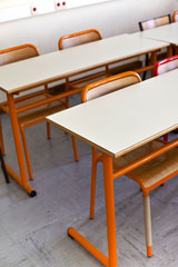 tables and chairs in a classroom